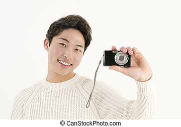 Asian young man with digital camera