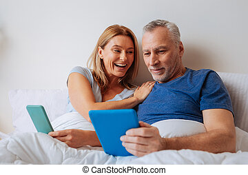 Beaming loving wife asking her husband to buy her new jewelry