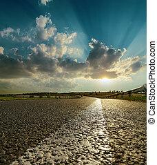 asphalt road closeup to sunset