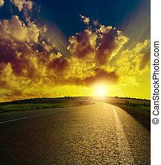 asphalt road to sunset