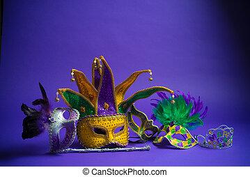 Assorted Mardi gras mask on purple background