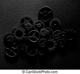 Assorted metal machine gears and components background