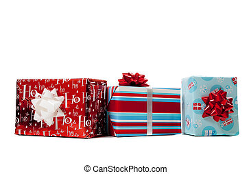 Assorted wrapped Christmas presents on a white background