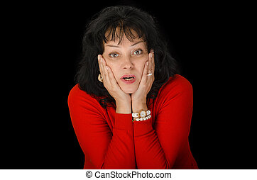 Astonished woman in red sweater