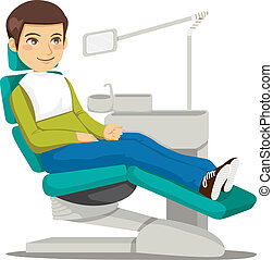 Young man sitting on the dentist chair waiting the doctor