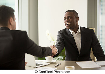 Attractive african businessman and caucasian business partner ha