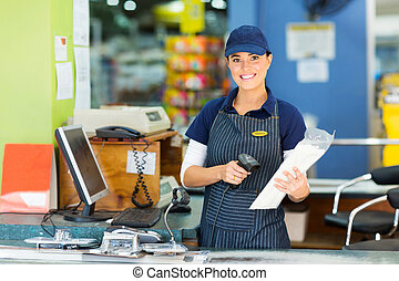 female cashier at hardware store