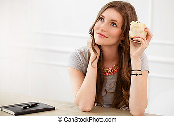 Attractive girl with moneybox