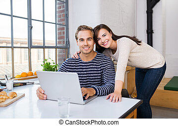 Attractive loving couple posing in the kitchen