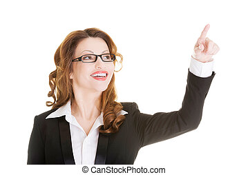 Attractive smiling businesswoman making choose