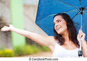 woman having fun in the rain