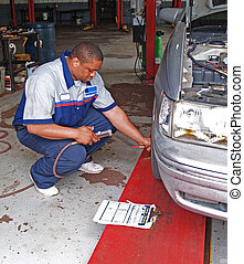 Auto Mechanic Performing Tire Press