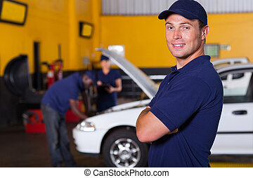 auto service business owner portrait inside workshop