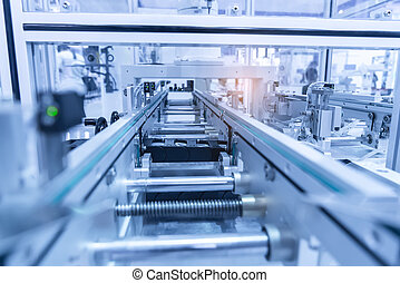Automatic robot in assembly line working in factory. Smart factory industry 4.0 concept.