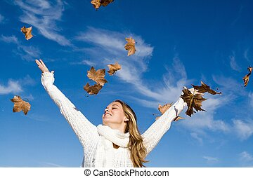 autumn woman arms raised in happiness