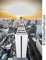 Bangkok skyline with urban skyscrapers at sunset.