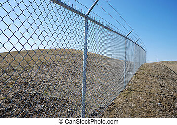 barbed fence over the blue sky background