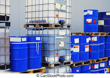 Pallets with blue drums and white container