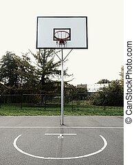 Urban Basketball hoop at sunset with skyline