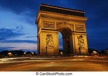Beautifly lit Triumph Arch at night. Paris, France.