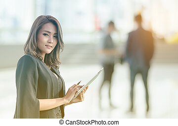 businesswoman holding tablet computer and smile