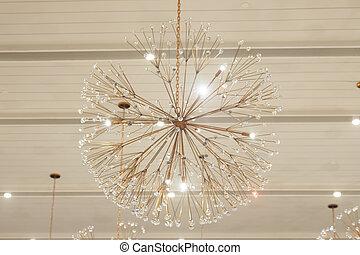 Beautiful chandelier in big hall