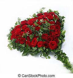 beautiful heart of red roses surrounded by ivy leaves