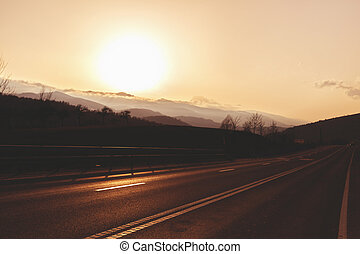 beautiful landscape with mountain road at sunset