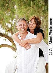 Beautiful mature couple having fun