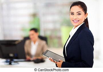 modern businesswoman holding tablet computer