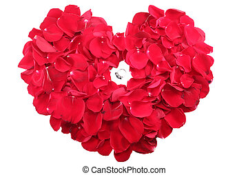Beautiful ring in the middle of a heart of red roses petals
