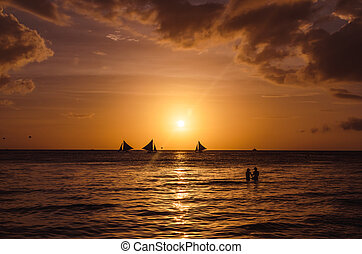 Beautiful sunset and sailboats