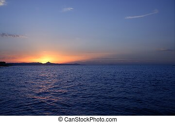 Beautiful sunset sunrise over blue sea ocean red sun sky