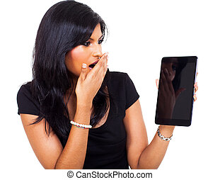 surprised businesswoman holding tablet computer