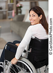 beautiful woman in her wheelchair at home
