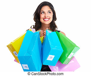 Beautiful woman with a shopping bag. Isolated on white.