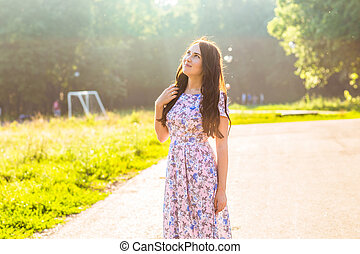 beautiful young brunette woman on the park