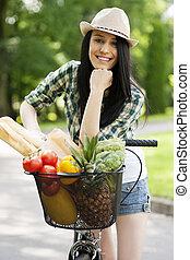 Beautiful young woman with bike