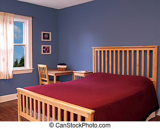 Beautiful, modern bedroom decorated in blue and red with mission style furniture. Photographs hanging on the wall were taken by the same photographer and do not pose a problem with copyright.