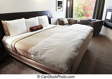 Bedroom with comfortable bed in neutral colors