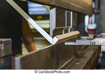 Bending of metal on the machine.