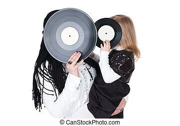 big and little girls with vinyl discs
