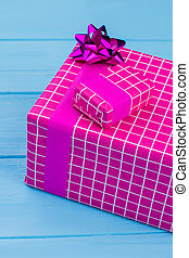 Big and little purple gift boxes.
