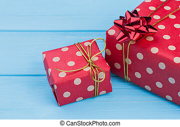 Big and little red dotted gift boxes.
