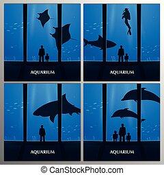 Big Aquarium, Oceanarium or Dolphinarium With dolphin, shark and crampfish. People with children watching the underwater world.