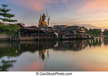 Big buddha statue in thailand at sunset