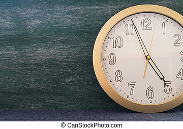 big clock with chalkboard background copy space for concept idea