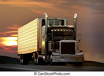 big truck driving on a highway with sunset in background
