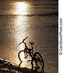 Bike silhouette in the river
