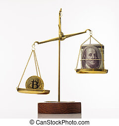 Bitcoin value increase trend. The coin outweighs the balance. On another bowl a stack of hundred dollar bills